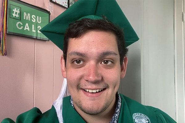 A man wearing a cap and gown