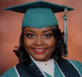 a girl with short dark hair wearing a green cap and gown